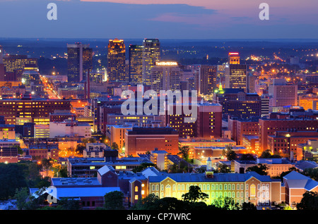 Downtown skyline of Birmingham, Alabama, USA at night. - Stock Photo