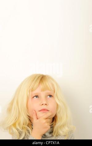 Stock Photo of child thinking - Stock Photo