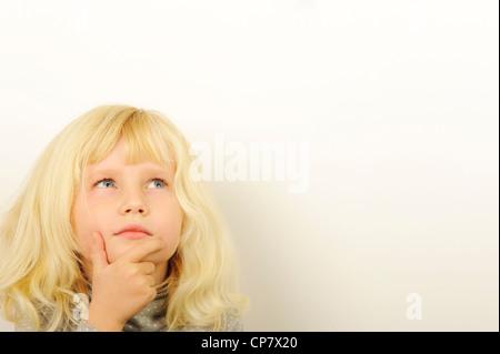 Stock Photo of child thinking. - Stock Photo