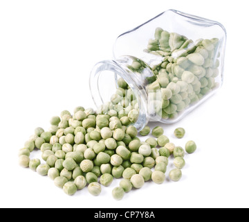 green peas scattered on a white background from glass jar - Stock Photo