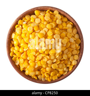 wooden bowl full of yellow split lentils isolated on white background Stock Photo