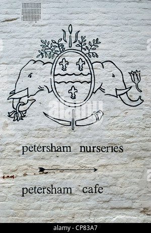 white wall with hand drawn crest and directions for petersham nurseries and petersham cafe, petersham, surrey, england - Stock Photo