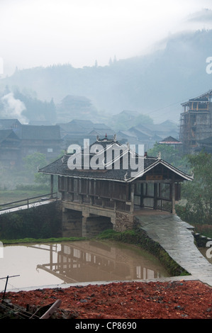 Roofed bridge in a traditional Dong village, Chengyang - Stock Photo