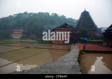 Watered rice fields and 'Drum Tower' in a Dong traditional village, Chengyang - Stock Photo
