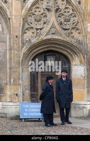 Two porters at Trinity College, Cambridge University, Cambridge UK - Stock Photo