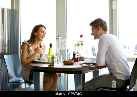 Portrait of a couple enjoying each other's company in a romantic dinner - Stock Photo