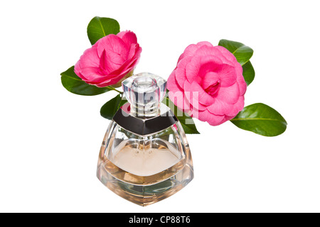 Golden color perfume bottle with pink flowers on white background - Stock Photo