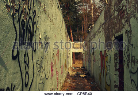 Passage with graffiti covered walls (former Red Army garrison town) - Stock Photo