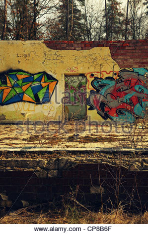 Graffiti covered wall (former Red Army garrison town) - Stock Photo