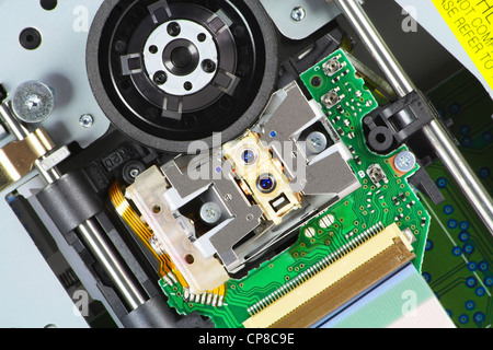 The modern blu-ray laser unit for reading Blue-Ray and DVD of disks. Mass production. Selective focus. - Stock Photo