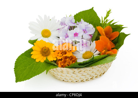 Easter wattled basket with summer flowers. Isolated on white. - Stock Photo