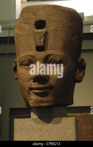 Colossal sandstone head of an Egyptian pharaoh, probably Thutmose I. Around 1500 BC. 18th Dynasty. New Kingdom. - Stock Photo