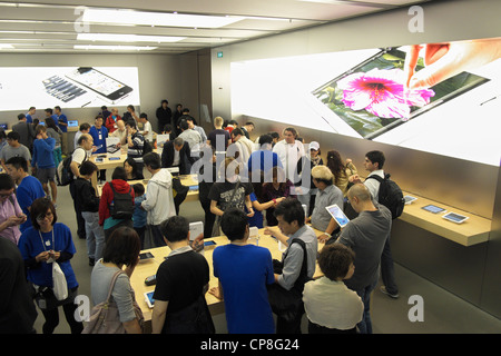 Interior view of busy Apple store in Hong Kong - Stock Photo