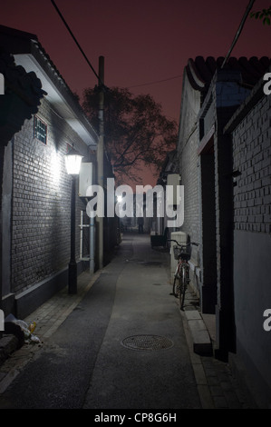 View of historic lane or hutong at night in Beijing China - Stock Photo