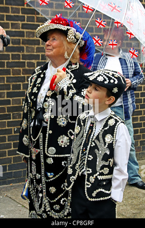 Pearly Kings and Queens outside 'The Carpenters Arms' pub in East London - Stock Photo