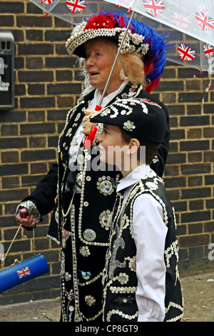 Members of the Pearly Kings and Queens outside 'The Carpenters Arms' pub in East London - Stock Photo