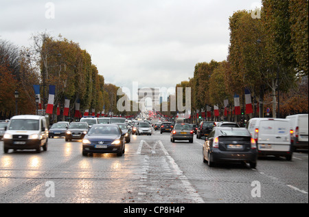 Traffic on the Avenue des Champs-Élysées in Paris - Stock Photo