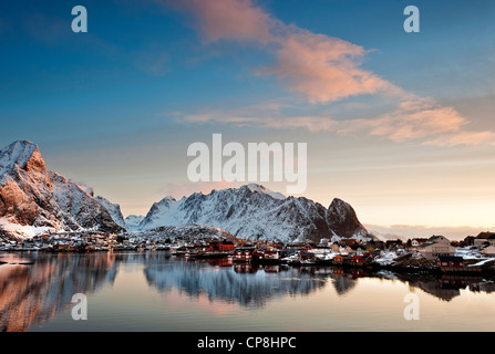 Sunrise over Olstind with Reine village in the foreground - Stock Photo