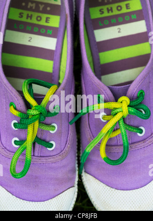 Colourful childs plimsolls - Stock Photo