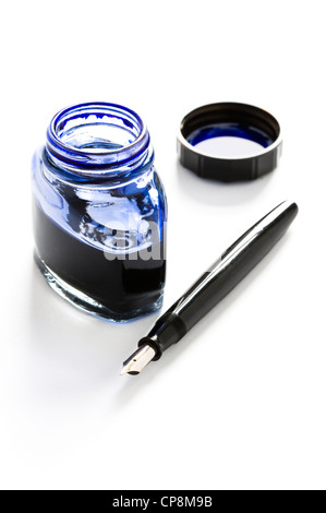 fountain pen, bottle of blue ink and lid isolated on a white background - Stock Photo
