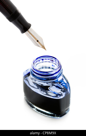 filling a fountain pen with blue ink from a bottle isolated on a white background - Stock Photo