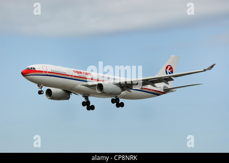 China Eastern AirBus A330-200 On final approach. - Stock Photo