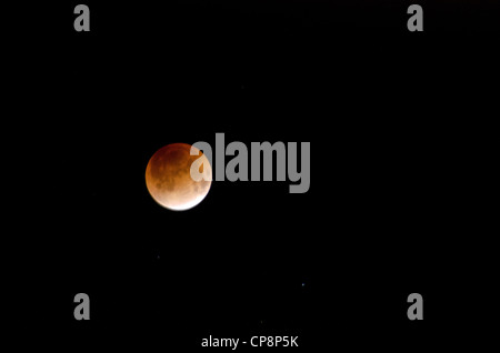 Red moon during a lunar eclipse on a black sky - Stock Photo