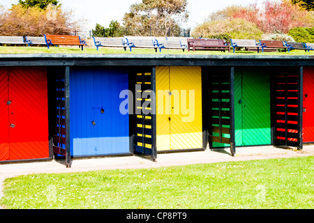 Beach huts painted in bright colours on Southsea seafront Hampshire - Stock Photo