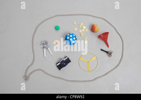 Variety of objects in speech bubble - Stock Photo
