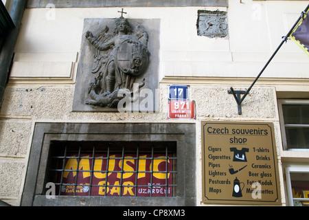 Music Bar Czech souvenir shop  St George Cigarettes cigars ceramics marionettes pipes T-shirts postcards Prague - Stock Photo