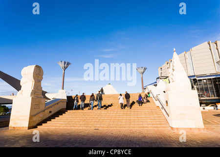 A group of people walking up the steps in Civic Square, Wellington, New Zealand. - Stock Photo