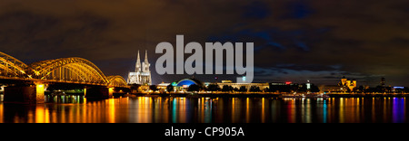 Germany, Cologne, View of Cologne Cathedral and Hohenzollern Bridge with River Rhine - Stock Photo