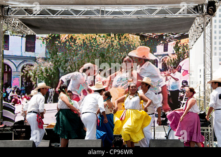 Performance by traditional costumed Mexican dancers at Cinco de Mayo celebrations in Olvera Street Los Angeles California - Stock Photo