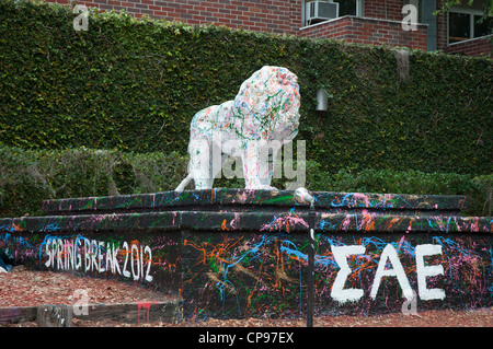 University of Florida campus Gainesville graffiti tagged statue in front of fraternity house. - Stock Photo