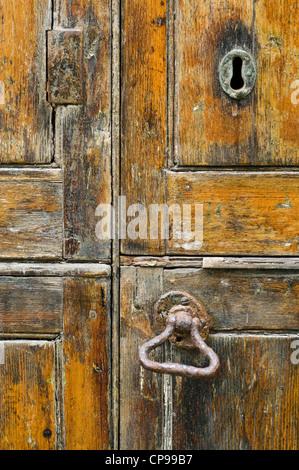 Detail of a heavy wooden door - Stock Photo