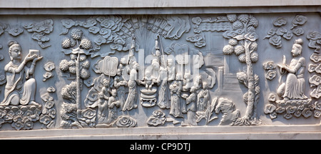 Stone Buddhist Panel Jing An Tranquility Temple Shanghai China Richest Buddhist temple in Shanghai Panel Shows Baby - Stock Photo