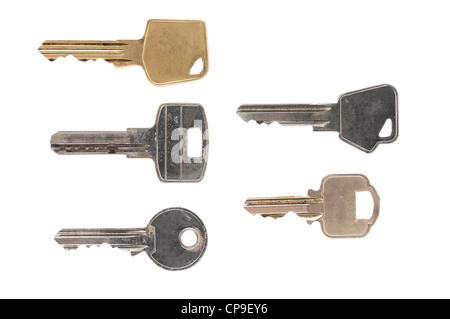 Five different kinds of door keys on white background - Stock Photo