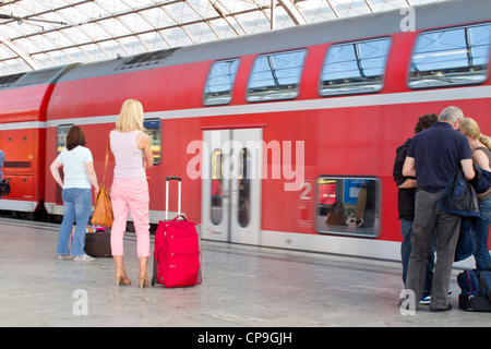 The German Railway in Berlin - Spandau.  A mainline train arriving with passengers on the platform interior of a - Stock Photo