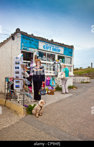 Visitors browse the postcards at the gift shop at Lizard Point, Cornwall, UK - the most southerly point on the English - Stock Photo