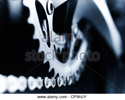 bicycle chain,bicycle gear,black and white,chain,close up,cog,complexity,detail,focus on foreground,horizontal,link,metal,no - Stock Photo