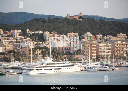 Palma is the major city and port on the island of Majorca. Bellver castle is on the hilltop above the city. - Stock Photo