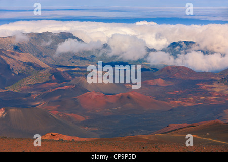 Sunset above the clouds over 3000 meters with a view inside the Haleakala Volcano, Maui, Hawaii - Stock Photo