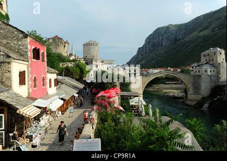 Cobbled street and the Stari Most Peace Bridge on the Neretva river.Mostar.Bosnia- Herzegovina.Balkans.Europe. - Stock Photo