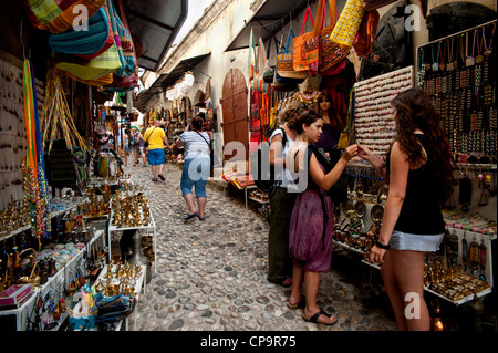 Souvenirs shops in a cobbled street known as Kujundziluk in Mostar old town .Bosnia- Herzegovina. Balkans .Europe. - Stock Photo