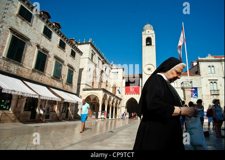 Main street Stadrun, Sponza Palace and Bell Tower in Luza Square , Old Town, Dubrovnik. Croatia. - Stock Photo