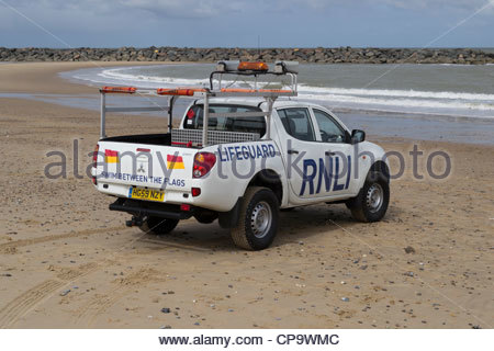 An RNLI Lifeguard vehicle on a Norfolk beach for a training exercise - Stock Photo
