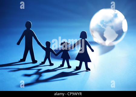 Paper chain family moving towards the light - Stock Photo