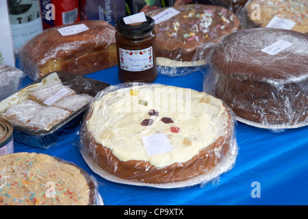 home made cakes buns and chutney on a charity stall in a market in the uk - Stock Photo