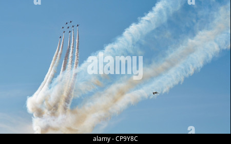 Hawk T Red Arrow jets from the British Air Force perform aerobatics and mid air stunts on July 23, 2011 in Southport, - Stock Photo