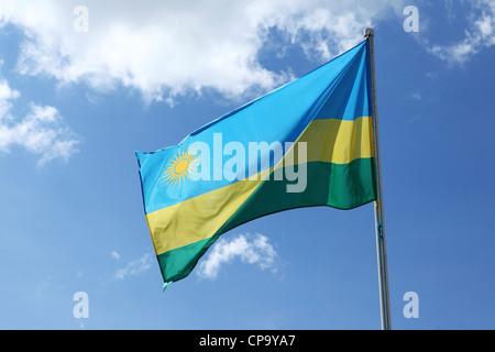 The national flag of Rwanda. - Stock Photo